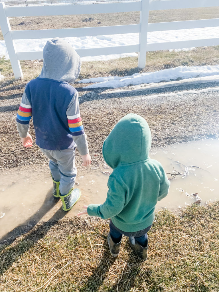 Toddlers and Kids Playing Outside in Muddy Puddles | 1000 Hours Adventure - February Recap | IgniteNourishThrive.com