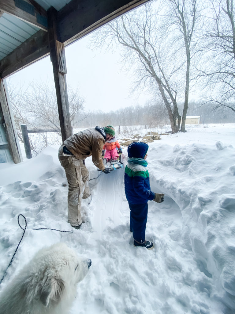 1000 Hours Outside Adventure, Dad and Kids playing outside in the snow, building a snow fort | 1000 Hours Adventure - February Recap | IgniteNourishThrive.com